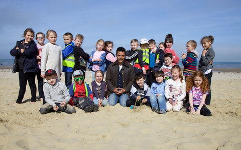 Dr Javid Abdelmoneim with the kids on a school outing to the beach - Credit:  Outline Productions/2