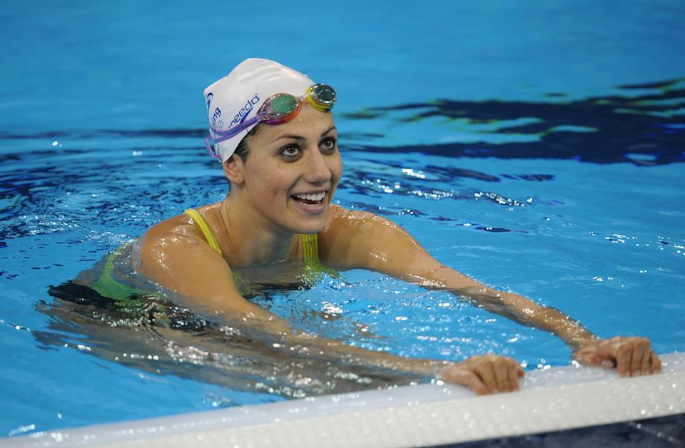 Australia's Stephanie Rice talks with teammates in the pool during a training session for the swimming competition in the FINA World Championships at the indoor stadium of the Oriental Sports Centre in Shanghai on July 22, 2011. (PETER PARKS/AFP/Getty Images)