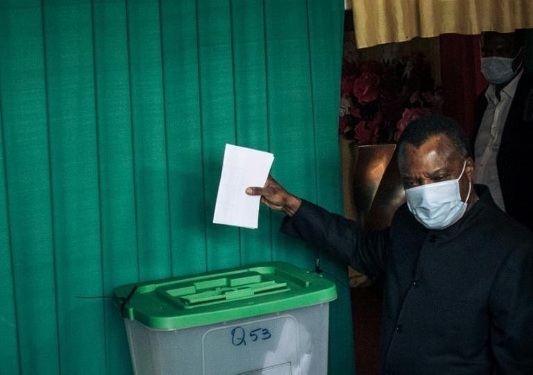 President Denis Sassou Nguesso, pictured casting his ballot in Brazzaville on Sunday