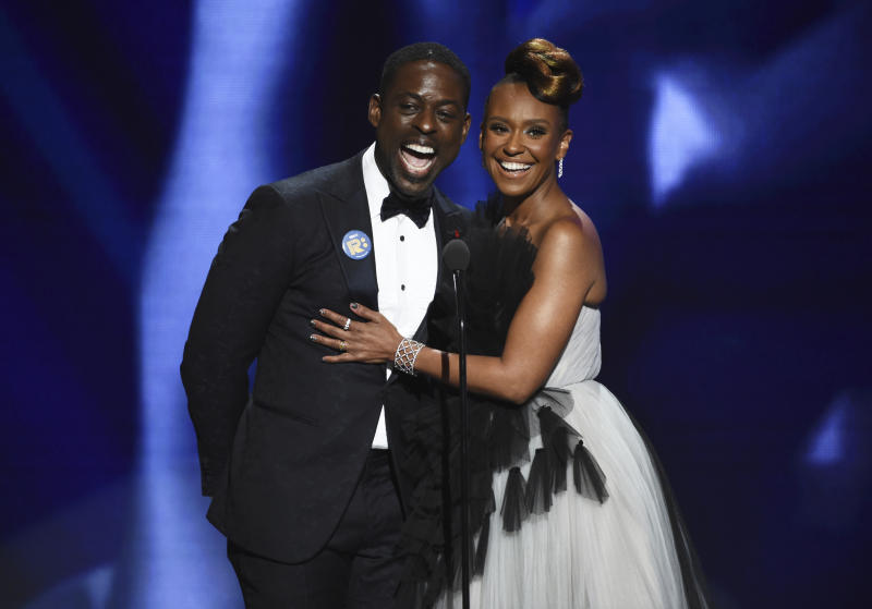 Sterling K. Brown, left, and Ryan Michelle Bathe speak on stage at the 51st NAACP Image Awards at the Pasadena Civic Auditorium on Saturday, Feb. 22, 2020, in Pasadena, Calif. (AP Photo/Chris Pizzello)