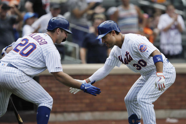 New York Mets' Michael Conforto, right, is greeted by teammate Pete Alonso after hitting a solo run home run against the Miami Marlins in the seventh inning of a baseball game, Wednesday, Aug. 7, 2019 in New York. (AP Photo/Mark Lennihan)