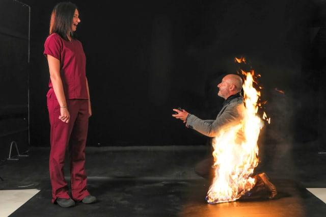 A professional stuntman is thought to have become the world's first person to propose to his fiancée whilst being on fire.
