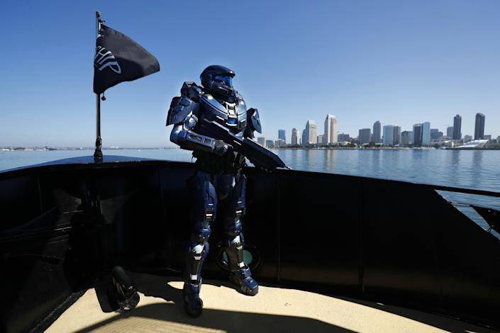 "Shane Holly dressed as Spartan 2296, from the video game ""Halo,"" on board the Flagship Cruises Cabrillo in San Diego Bay. Holly spent two years working on this 3D printed and fabricated outfit. He has been to every Comic-Con since 1997. His favorite was the first time he took his daughter and they cosplayed together, as they have done for eight years. <span class=""copyright"">(K.C. Alfred / The San Diego Union-Tribune)</span>"