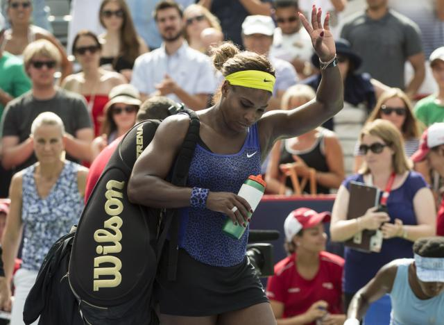 Serena Williams of the United States walks off the court after losing 6-7, 6-2, 6-3 to her sister Venus during semifinal play at the Rogers Cup (AP Photo/The Canadian Press, Paul Chiasson)