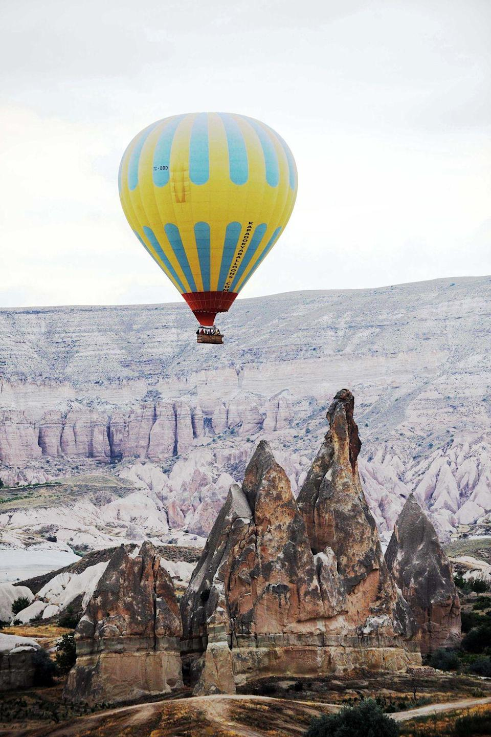 """<p><strong>Cappadocia, Turkey</strong></p><p>The Cappadocia region of Turkey looks like something created for a fantasy movie, with towering, psychedelic rock formations. The quintessential experience is floating over the landscape in a hot air balloon, and they generally take off in the early morning hours to see the sunrise. Most of the activities are for the outdoorsy — hiking to various rock formations and exploring caves in Ala Dağlar National Park. You can also visit the underground cities of Derinkuyu and Kaymakli, which are carved out below the ground (and not for those with claustrophobia), and head to volcanic rock outcropping Uçhisar Castle.</p><span class=""""copyright"""">Photo: Chine Nouvelle / REX Shutterstock. </span>"""