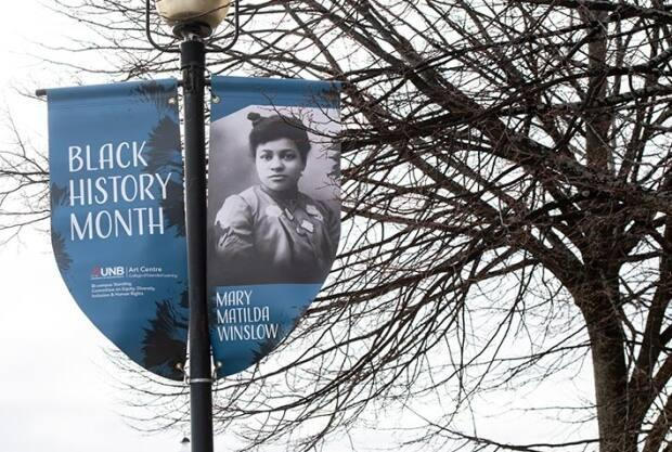 Twenty-eight banners have been affixed to light posts along Fredericton's Queen Street to celebrate New Brunswick's Black history, including one featuring Mary Matilda Winslow.
