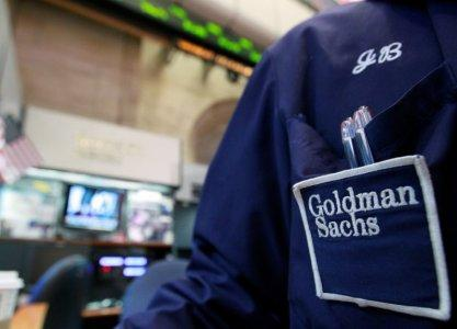 FILE PHOTO - A trader works at the Goldman Sachs stall on the floor of the New York Stock Exchange, April 16, 2012. REUTERS/Brendan McDermid/File Photo