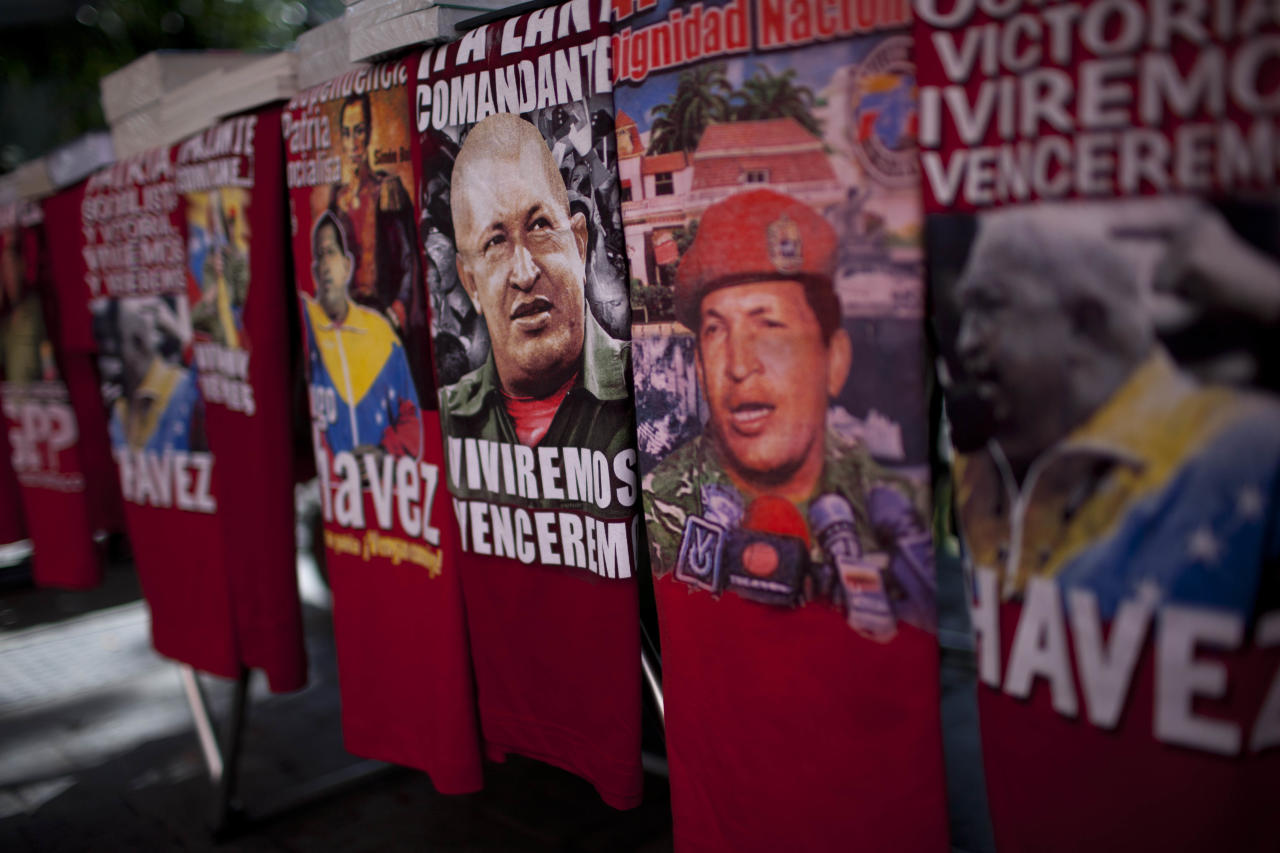 T-shirts blazoned with the image of Venezuela's President Hugo Chavez are displayed for sale on a street in Caracas, Venezuela, Friday March 2, 2012. Chavez has been in Cuba since last Friday to have a growth removed in the same part of the pelvis where a larger, malignant tumor was extracted last year. Chavez said Friday he's recovering quickly from tumor surgery, that doctors have put him on a special diet, and that he's taking daily walks. (AP Photo/Ariana Cubillos)