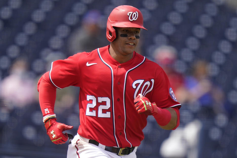 Washington Nationals' Juan Soto (22) runs after hitting a single during the first inning of a spring training baseball game against the New York Mets, Monday, March 8, 2021, in West Palm Beach, Fla. (AP Photo/Lynne Sladky)
