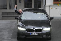 """German scientist Benjamin List waves out of a car as he arrives at the Max-Planck-Institute for Coal Research in Muelheim, Germany, Wednesday, Oct. 6, 2021. Two scientists have won the Nobel Prize for chemistry for finding an """"ingenious"""" new way to build molecules that can be used to make everything from medicines to food flavorings. Benjamin List of Germany and Scotland-born David W.C. MacMillan developed """"asymmetric organocatalysis."""" (AP Photo/Martin Meissner)"""
