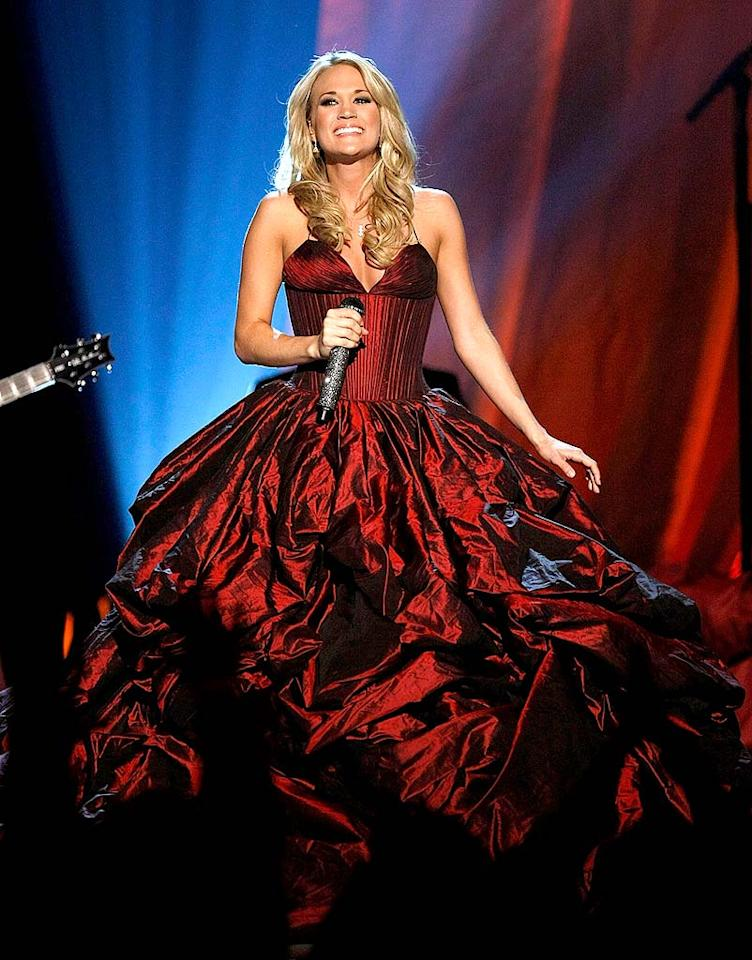 """Carrie Underwood caused a commotion at the 44th Annual Academy of Country Music Awards in a billowing burgundy beauty, courtesy of Rafael Cennamo. Ethan Miller/<a href=""""http://www.gettyimages.com/"""" target=""""new"""">GettyImages.com</a> - April 5, 2009"""