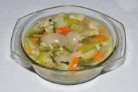 """Soups made with multiple vegetables are very nutritive. Heat some olive oil in a pan. Add some chopped garlic, celery, onions, bell peppers and carrots. Add some vegetable stock to this and stir well. Add in chopped cabbage and allow the soup to cook. Cook for 15 minute and serve hot. """"Creative Commons Vegetables Stew"""" by Biswarup Ganguly is licensed under CC BY 3.0. Image for representation purposes."""