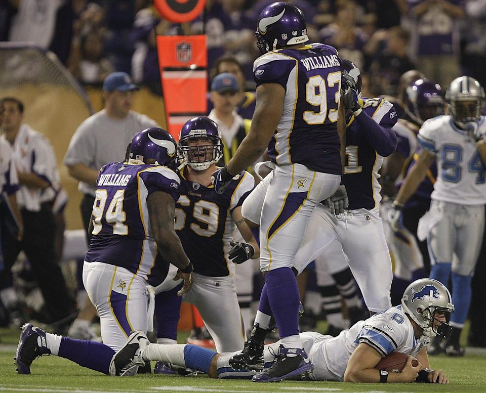 Lions quarterback Dan Orlovsky is sacked by the Vikings' Jared Allen and Pat Williams during the second half of the Lions' 12-10 loss on Oct. 12, 2008, at the Metrodome.