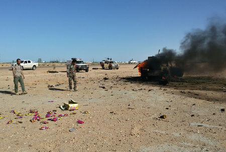 Smoke rises from a burning vehicle following clashes between members of the eastern-based Libyan National Army (LNA) and fighters from Benghazi Defence Brigades (BDB), in Ras Lanuf,
