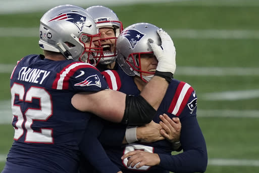 New England Patriots kicker Nick Folk celebrates his game-winning field goal with lineman Joe Thuney, left, and holder Jake Bailey, rear, as time expires in an NFL football game against the Arizona Cardinals, Sunday, Nov. 29, 2020, in Foxborough, Mass. (AP Photo/Elise Amendola)