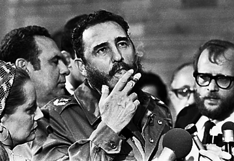Fidel Castro smokes a cigar during interviews with the press in Havana during a visit of U.S. Senator Charles McGovern in this file photo from May 1975. Picture taken May 1975 REUTERS/Prensa Latina (CUBA)