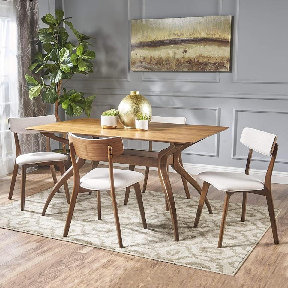 <p>This <span>Christopher Knight Home Nissie Mid-Century Wood Dining Set</span> ($811) is not only useful, but the neutral theme will also help it blend with any decor. We're fans of the look and price tag.</p>