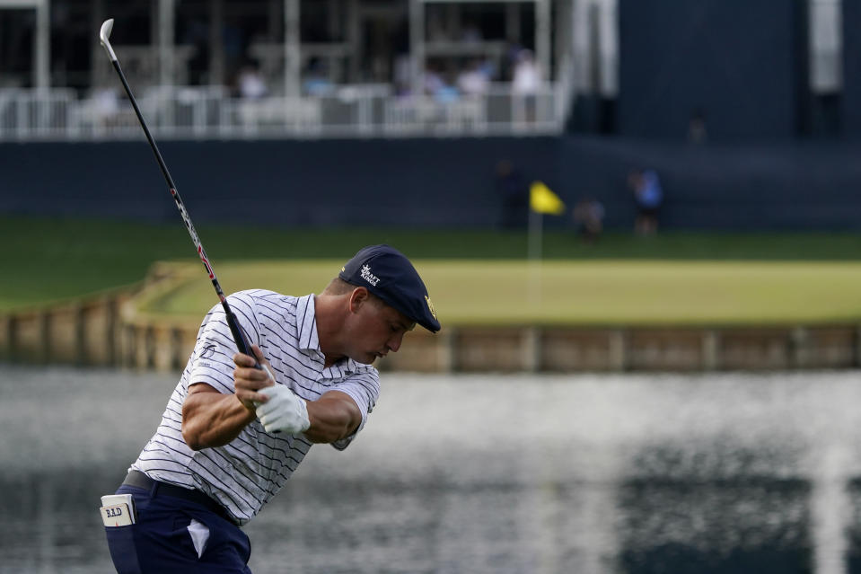 Bryson DeChambeau hits his tee shot on the 17th hole during the third round of The Players Championship golf tournament Saturday, March 13, 2021, in Ponte Vedra Beach, Fla. (AP Photo/John Raoux)