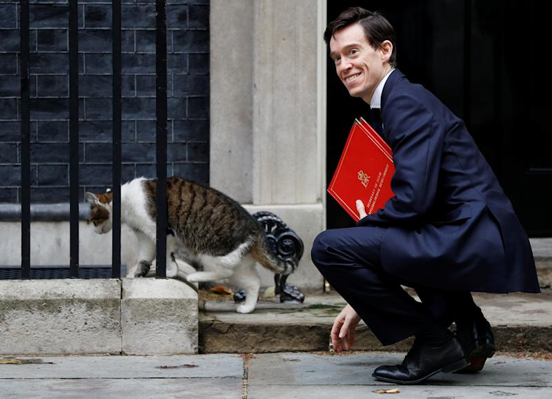 Rory Stewart pets Larry the cat outside Number 10 Downing Street, but could he be moving in soon? (Picture: Reuters)