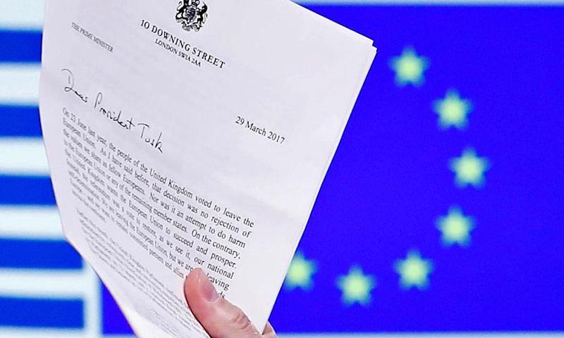 European Council president Donald Tusk holds Theresa May's Brexit letter in Brussels