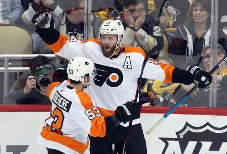 Mar 17, 2019; Pittsburgh, PA, USA; Philadelphia Flyers center Sean Couturier (14) celebrates after scoring the game winning goal with defenseman Shayne Gostisbehere (53) against the Pittsburgh Penguins in overtime at PPG PAINTS Arena. Philadelphia won 2-1 in overtime. Mandatory Credit: Charles LeClaire-USA TODAY Sports