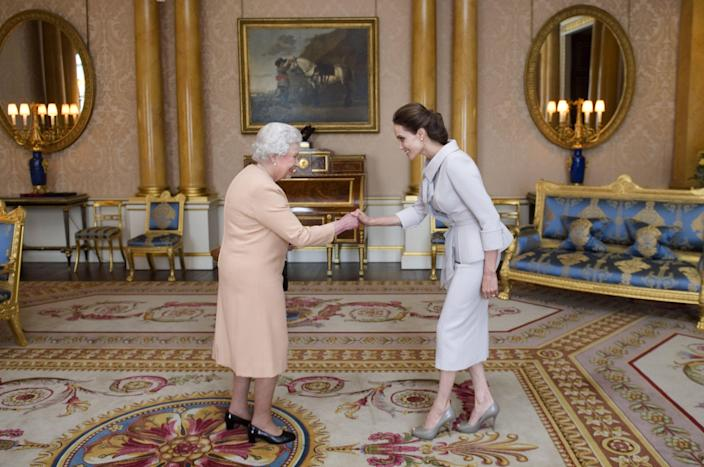 <p>Fashion thought exercise: What would you wear to meet the Queen of England, aka the fanciest day of your whole entire life? GO! Jeans? Your prom dress? A power suit? I have a feeling the Queen would not appreciate it if you broke out your wedges for the occasion, just sayin'. Here, find out what 50 famous people decided to wear when they whipped out their best curtsy for her Majesty, from the classic looks to the ever-so-<em>sliiiiightly</em> inappropriate ones. </p>