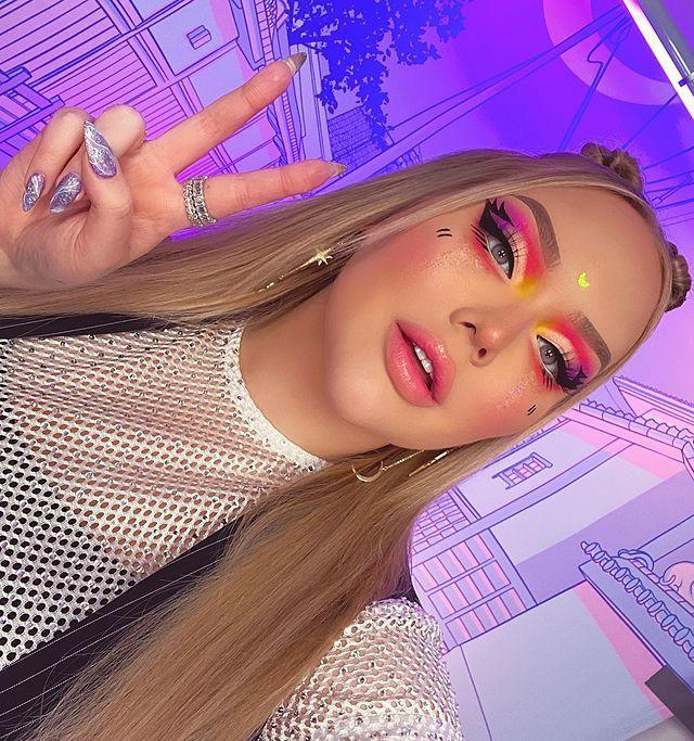 """<p>Nikkie's nails are always just as cool as her makeup, with lavender glitter and a cool abstract design. </p><p><a href=""""https://www.instagram.com/p/B9FcPACp-_A/"""" rel=""""nofollow noopener"""" target=""""_blank"""" data-ylk=""""slk:See the original post on Instagram"""" class=""""link rapid-noclick-resp"""">See the original post on Instagram</a></p>"""
