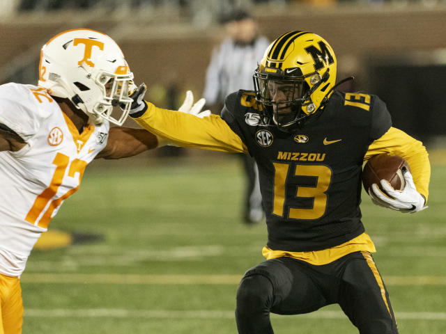 Missouri wide receiver Kam Scott, right, pushes past Tennessee defensive back Shawn Shamburger during the fourth quarter of an NCAA college football game, Saturday, Nov. 23, 2019, in Columbia, Mo. Tennessee won the game 24-20. (AP Photo/L.G. Patterson)