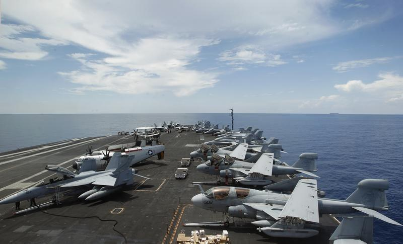 A general view of the aircrafts on the flight deck during a tour of the USS Nimitz aircraft carrier on patrol in the South China Sea May 23, 2013. REUTERS/Edgar Su