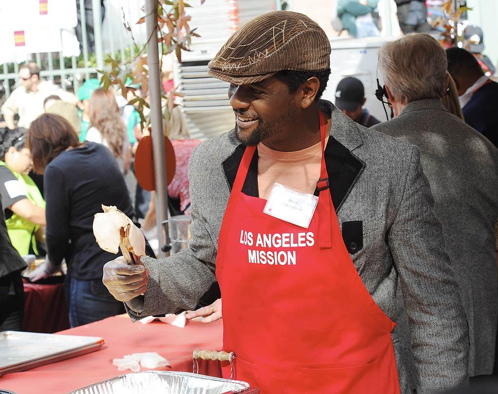 Blair Underwood also volunteered to serve up turkey -- with a smile! (11/23/2011)