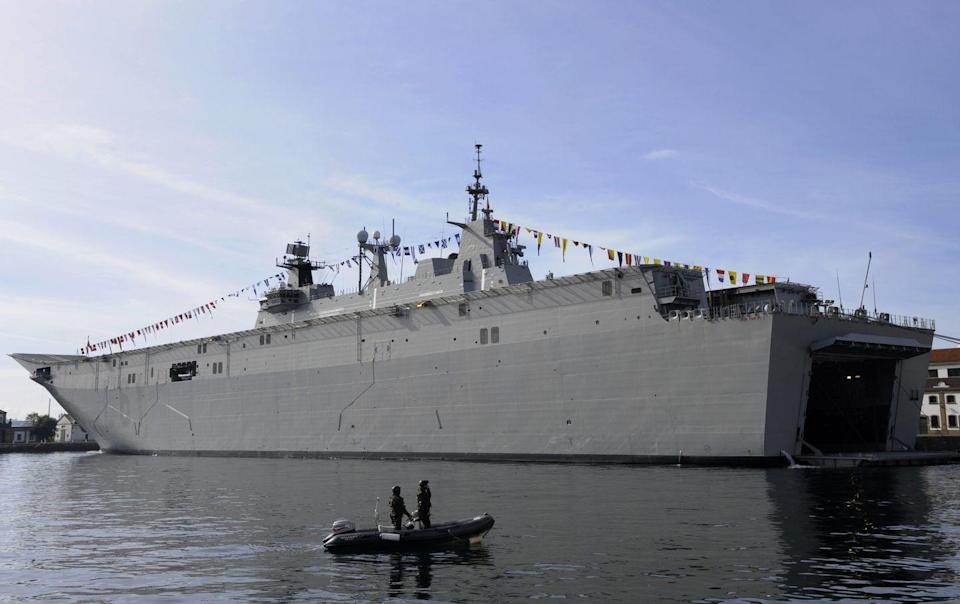 "<p>Named after the Spanish king who abdicated in 2014, <em>Juan Carlos I</em> is an amphibious ship with a dedicated aviation role. Measuring 754 feet long and displacing 27,082 tons when fully loaded, the ship can land nearly a thousand Spanish marines by air and sea. </p><p><em>Juan Carlos I</em> has a full-length flight deck, too, plus a pair of elevators and hangar. It has a 12-degree ski jump for launching Sea Harrier jump jet fighters. The ship can carry up to 30 helicopters or 10 to 12 Sea Harriers, or some mixture of both. </p><p>The Spanish Navy's <a href=""http://www.armada.mde.es/ArmadaPortal/page/Portal/armadaEspannola/buques_superficie/02_lhd-juan-carlos-i"" rel=""nofollow noopener"" target=""_blank"" data-ylk=""slk:website"" class=""link rapid-noclick-resp""><u>website</u></a> states <em>Juan Carlos I</em> can carry the F-35B, the vertical takeoff and landing version of the Joint Strike Fighter, even though there are no official plans yet by the Spanish government to buy any of the jets.</p>"