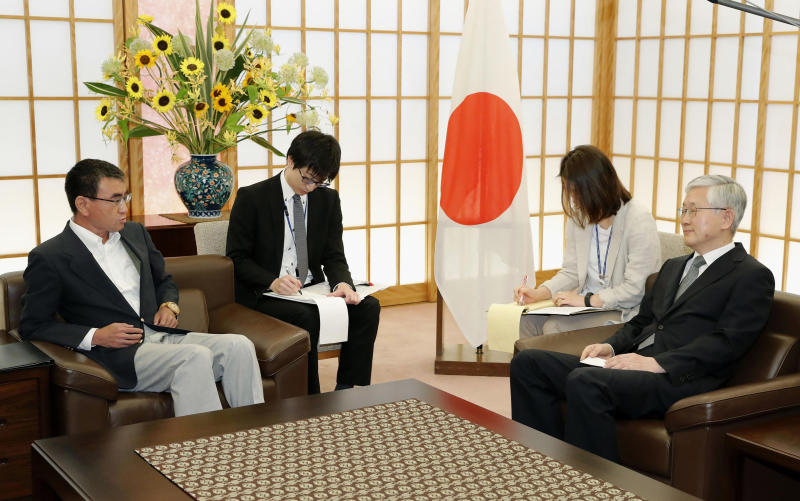 Japan's Foreign Minister Taro Kono, left, meets with South Korean Ambassador to Japan Nam Gwan Pyo, right, at foreign ministry in Tokyo Friday, July 19, 2019. Japan has summoned South Korea's ambassador to protest Seoul's refusal to join in an arbitration panel to settle a dispute over World War II labor. (Masanobu Kumagai/Kyodo News via AP)