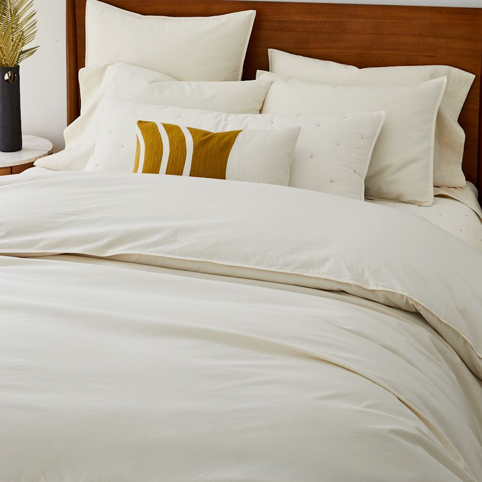 """<h3>West Elm</h3><br>Did you know this go-to store for all home decor needs has a range of 100% organic bedding made from GOTS certified cotton?<br><br><em>Shop <a href=""""https://www.westelm.com/"""" rel=""""nofollow noopener"""" target=""""_blank"""" data-ylk=""""slk:West Elm"""" class=""""link rapid-noclick-resp""""><strong>West Elm</strong></a></em><br><br><strong>West Elm</strong> Organic Washed Cotton Percale Duvet Cover & Shams, $, available at <a href=""""https://go.skimresources.com/?id=30283X879131&url=https%3A%2F%2Fwww.westelm.com%2Fproducts%2Forganic-washed-cotton-percale-duvet-cover-shams-t5431%2F"""" rel=""""nofollow noopener"""" target=""""_blank"""" data-ylk=""""slk:West Elm"""" class=""""link rapid-noclick-resp"""">West Elm</a>"""