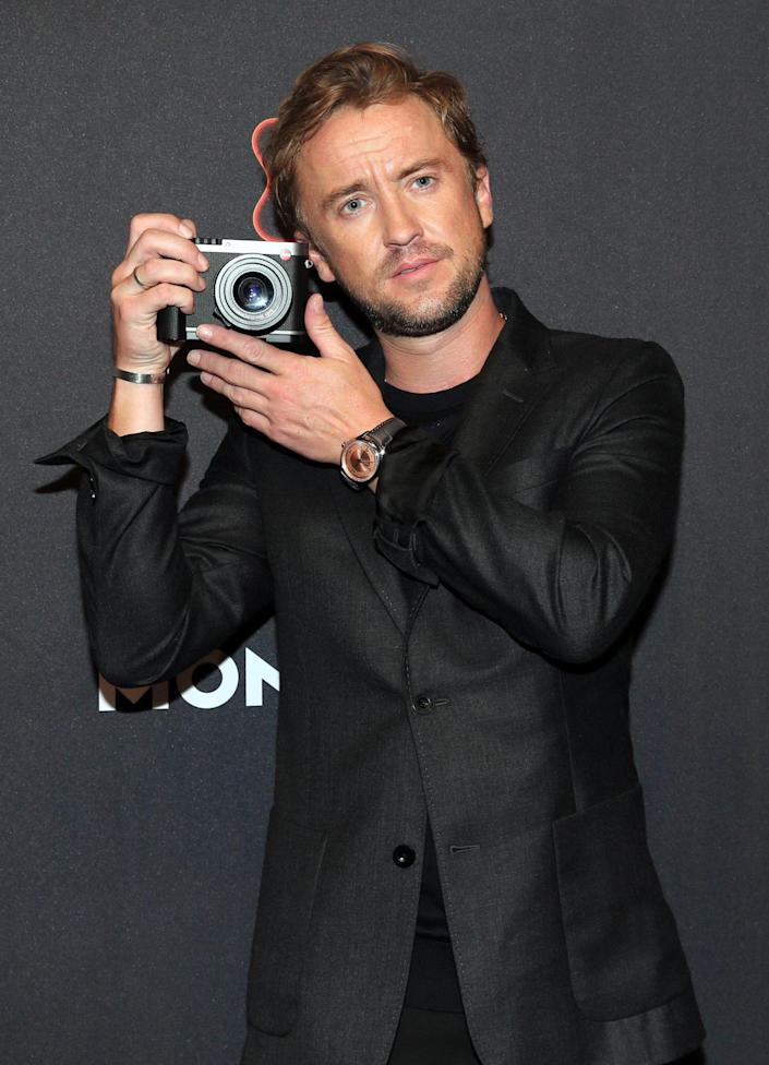 <p>Tom Felton snaps a photo during the Montblanc UltraBlack launch event at Feuerle Collection on Sept. 15 in Berlin.</p>