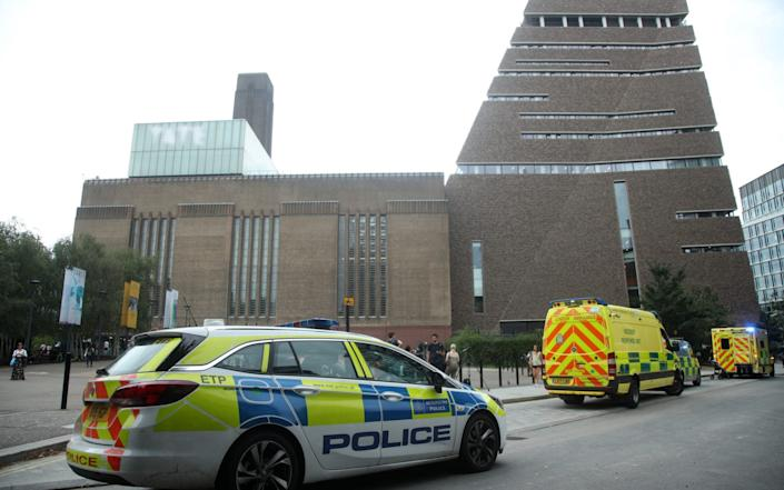 Emergency crews attending the scene at the Tate Modern art gallery following the incident - PA