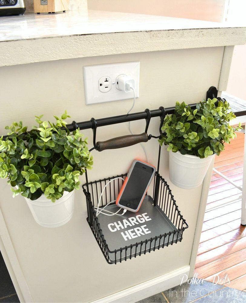 """<p>To keep electronics from cluttering your counter, you can mount this bar near an outlet along with a basket to hold your gadgets. This blogger even added potted plants for decoration.</p><p>See more at <a href=""""http://www.hometalk.com/8447440/diy-charging-station-using-ikea-s-fintorp-system"""" rel=""""nofollow noopener"""" target=""""_blank"""" data-ylk=""""slk:Hometalk"""" class=""""link rapid-noclick-resp"""">Hometalk</a>.</p><p><a class=""""link rapid-noclick-resp"""" href=""""https://www.amazon.com/Stupell-Home-Decor-Collection-Typography/dp/B010B7Q988/?tag=syn-yahoo-20&ascsubtag=%5Bartid%7C2089.g.29514474%5Bsrc%7Cyahoo-us"""" rel=""""nofollow noopener"""" target=""""_blank"""" data-ylk=""""slk:BUY NOW"""">BUY NOW</a> <em><strong>Hanging Basket, $8, <span class=""""redactor-unlink"""">amazon.com</span></strong></em><br></p>"""