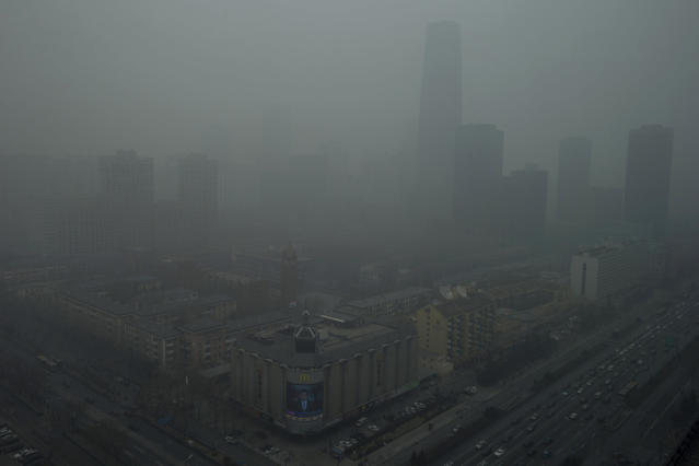 Skyscrapers are obscure by heavy haze in Beijing Sunday, Jan. 13, 2013. People refused to venture outdoors and buildings disappeared into Beijing's murky skyline on Sunday as the capital's air quality went off the index. (AP Photo/Ng Han Guan)