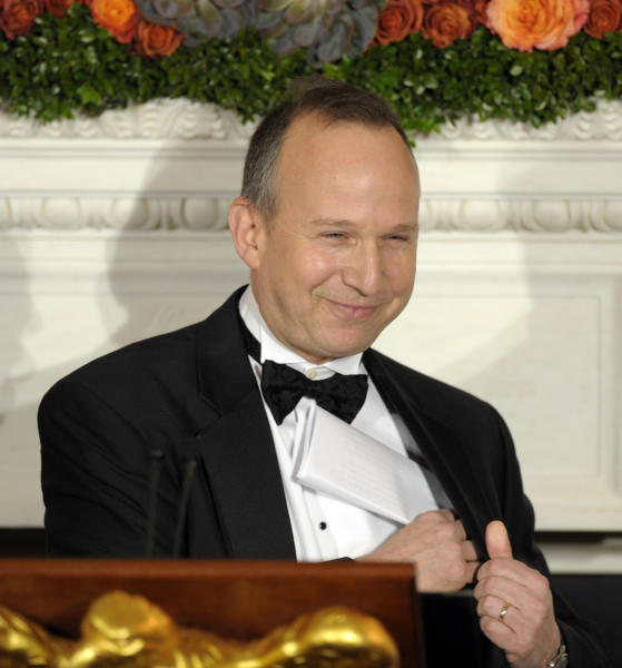 National Governors Association Chairman Gov. Jack Markell of Delaware puts his notes back in his pocket after speaking and offering a toast to President Barack Obama and governors of the National Governors Association at the 2013 Governors' Dinner at the White House in Washington, Sunday, Feb. 24, 2013. (AP Photo/Susan Walsh)