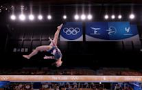 """<p>As for the year-long postponement of the Games, Lee told <a href=""""https://people.com/sports/tokyo-olympics-sunisa-lee-first-hmong-american-olympic-gymnast-achieving-her-dream/"""" rel=""""nofollow noopener"""" target=""""_blank"""" data-ylk=""""slk:PEOPLE"""" class=""""link rapid-noclick-resp"""">PEOPLE</a>, """"Now looking back, I think it's helped me a lot mentally and physically.""""</p>"""