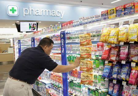 File photo of a worker stocking a Walgreens store in Chicago