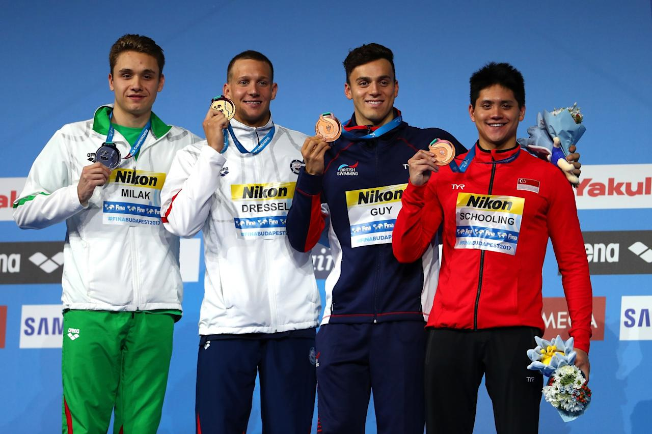 <p>Swimming – 17th FINA World Aquatics Championships – Men's Butterfly 100m Medal Ceremony – Budapest, Hungary – July 29, 2017 – Kristof Milak of Hungary (silver), Caeleb Remel Dressel of the U.S. (gold), James Guy of Britain (bronze) and Joseph Schooling of Singapore (bronze) pose with medals. REUTERS/Bernadett Szabo </p>