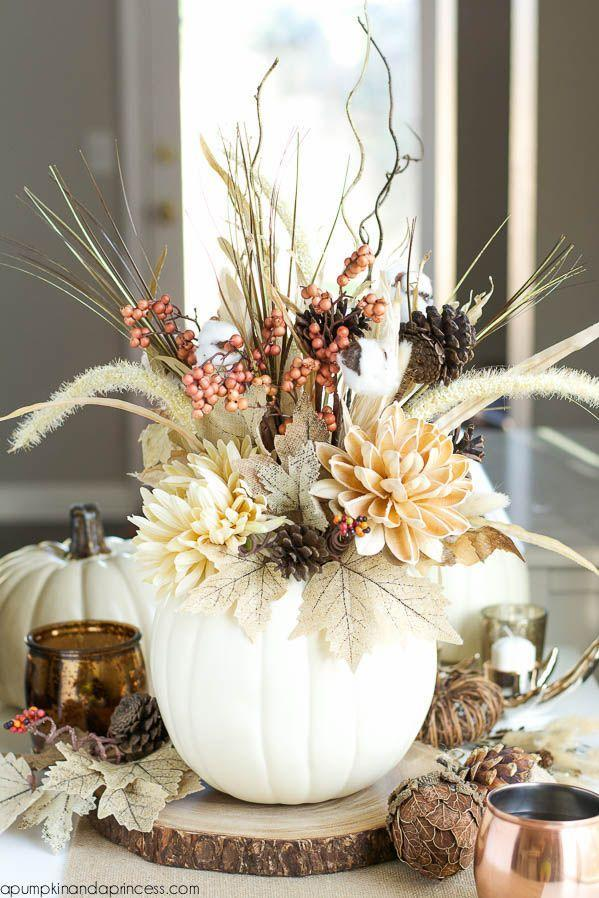 """<p>Subtlety is key when it comes to Thanksgiving centerpieces. You've already got so much on the table—why crowd it further? Here, a stunning, quiet arrangement of <a href=""""https://www.amazon.com/artificial-flowers/b?ie=UTF8&node=14087331&tag=syn-yahoo-20&ascsubtag=%5Bartid%7C10050.g.2130%5Bsrc%7Cyahoo-us"""" rel=""""nofollow noopener"""" target=""""_blank"""" data-ylk=""""slk:faux flowers"""" class=""""link rapid-noclick-resp"""">faux flowers</a> and <a href=""""https://www.amazon.com/slp/decorative-branches/mj2ndz7325mf5ue?tag=syn-yahoo-20&ascsubtag=%5Bartid%7C10050.g.2130%5Bsrc%7Cyahoo-us"""" rel=""""nofollow noopener"""" target=""""_blank"""" data-ylk=""""slk:branches"""" class=""""link rapid-noclick-resp"""">branches</a> is more than enough to make a serious statement.</p><p><strong>Get the tutorial at <a href=""""https://apumpkinandaprincess.com/diy-pumpkin-vase"""" rel=""""nofollow noopener"""" target=""""_blank"""" data-ylk=""""slk:A Pumpkin and a Princess"""" class=""""link rapid-noclick-resp"""">A Pumpkin and a Princess</a>.</strong></p><p><strong><a class=""""link rapid-noclick-resp"""" href=""""https://www.amazon.com/Elanze-Designs-Decorative-Pumpkins-Quantity/dp/B07CHVVC1S?tag=syn-yahoo-20&ascsubtag=%5Bartid%7C10050.g.2130%5Bsrc%7Cyahoo-us"""" rel=""""nofollow noopener"""" target=""""_blank"""" data-ylk=""""slk:SHOP FAUX WHITE PUMPKINS"""">SHOP FAUX WHITE PUMPKINS</a><br></strong></p>"""