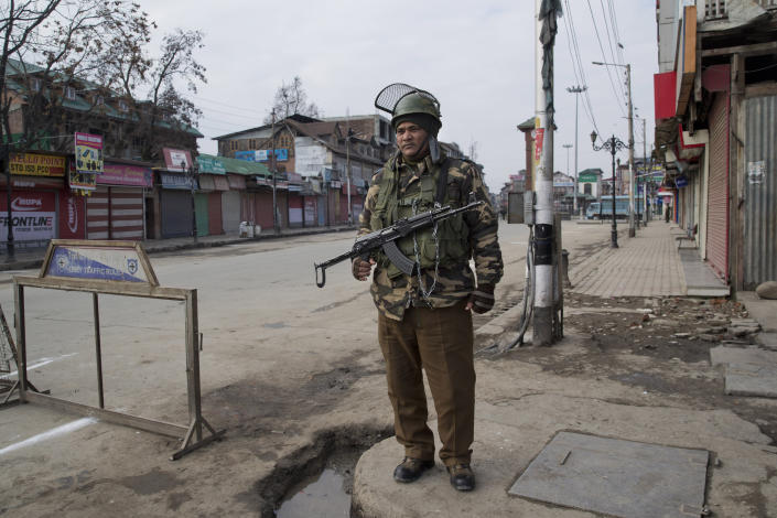 An Indian paramilitary soldier stands guard near a temporary check point during a strike in Srinagar, Indian controlled Kashmir, Sunday, Feb. 3, 2019. India's prime minster is in disputed Kashmir for a daylong visit Sunday to review development work as separatists fighting Indian rule called for a shutdown in the Himalayan region. (AP Photo/Dar Yasin)