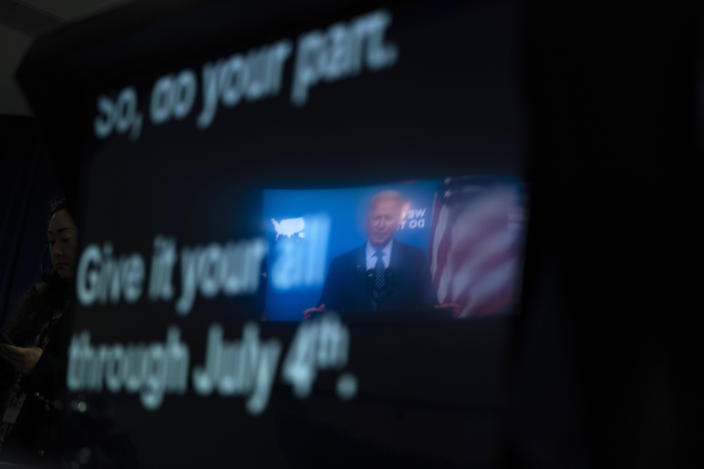 President Joe Biden is reflected in a teleprompter as he speaks about the COVID-19 vaccination program, in the South Court Auditorium on the White House campus, Wednesday, June 2, 2021, in Washington. (AP Photo/Evan Vucci)
