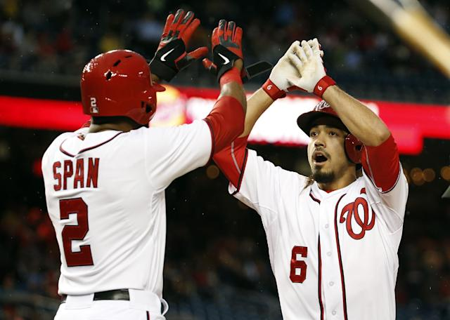 Washington Nationals' Denard Span (2) celebrates with Anthony Rendon (6) after being driven home by Rendon's two-run homer during the first inning of a baseball game against the Los Angeles Dodgers at Nationals Park, Monday, May 5, 2014, in Washington. (AP Photo/Alex Brandon)
