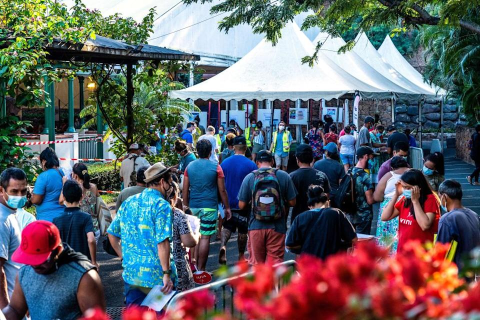 People arrive to be vaccinated at a temporary vaccination centre against Covid-19 set up in the centre of Papeete, French Polynesia.