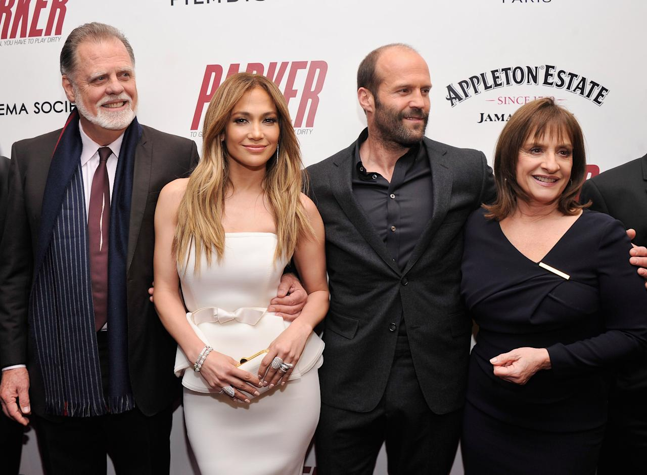 "NEW YORK, NY - JANUARY 23:  (L-R) Taylor Hackford, Jennifer Lopez, Jason Statham and Patti LuPone attend a screening of ""Parker"" hosted by FilmDistrict, The Cinema Society, L'Oreal Paris and Appleton Estate at MOMA on January 23, 2013 in New York City.  (Photo by Stephen Lovekin/Getty Images)"