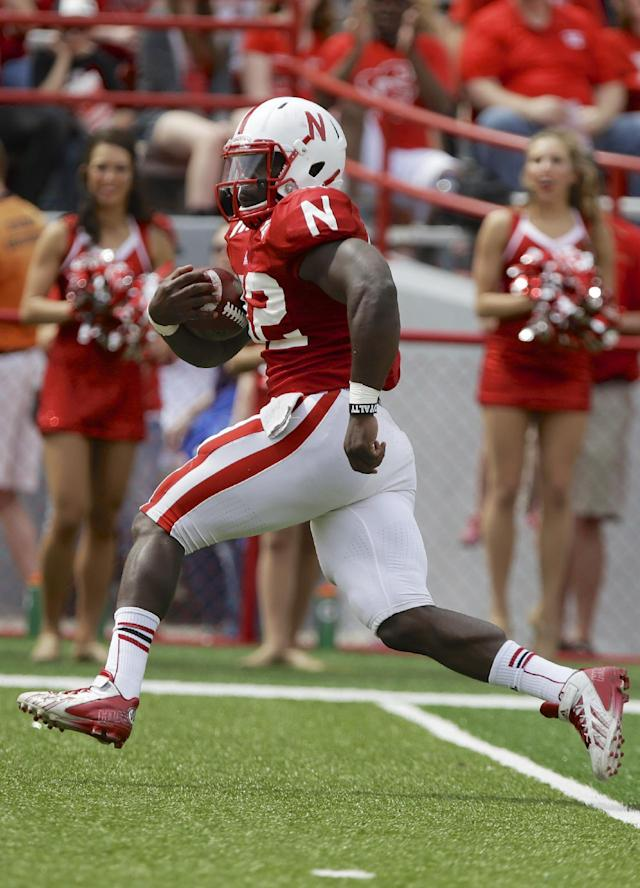 Nebraska running back Imani Cross carries the ball during Nebraska's NCAA college football spring game in Lincoln, Neb., Saturday, April 12, 2014. Cross ran for 100 yards and two touchdowns. (AP Photo/Nati Harnik)