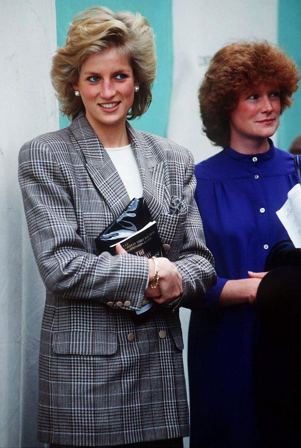 """<p>Diana chose an oversized blazer in a classic plaid print for an outing with her sister, <a href=""""https://www.townandcountrymag.com/society/tradition/a34288939/princess-diana-sister-lady-sarah-mccorquodale/"""" rel=""""nofollow noopener"""" target=""""_blank"""" data-ylk=""""slk:Lady Sarah McCorquodale"""" class=""""link rapid-noclick-resp"""">Lady Sarah McCorquodale</a>, in September 1989.<br></p>"""