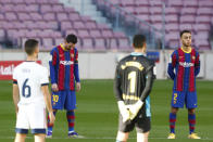 FC Barcelona and Osasuna players observe a minute of silence in memory of soccer legend Diego Armando Maradona before the start of the Spanish La Liga soccer match between FC Barcelona and Osasuna at the Camp Nou stadium in Barcelona, Spain, Sunday, Nov. 29, 2020. (AP Photo/Joan Monfort)